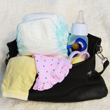 Women's handbag with items to care for the child Stock Images