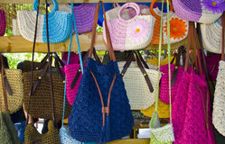 Women's handbags in a store. A close up of colorful shopping bags Royalty Free Stock Photo