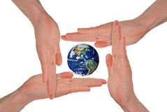 Women's hands around the Earth Stock Photography