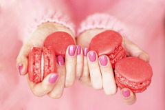 Women's hands with a beautiful pink manicure Stock Photography