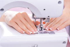 Women's hands behind her sewing Royalty Free Stock Photo