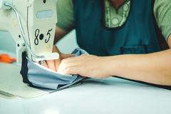 Women's hands behind her sewing. royalty free stock images
