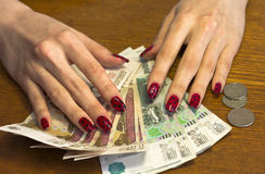 Women's hands on the bills,spread out like a fan Royalty Free Stock Image