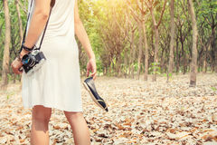 Free Women S Hands Carrying Shoes, And Retro Camera Walking In The Gr Stock Photo - 79483860