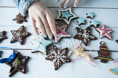 Women's hands and christmas cookies Stock Photo