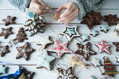 Women's hands and christmas cookies Stock Photography
