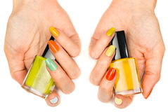 Women's hands with a colored nail varnish Stock Images