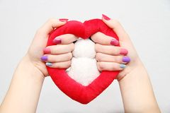 Women's hands with a colored nails Stock Photo