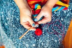 Women`s hands crochet. Handmade, crafts