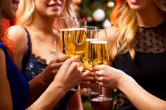 Women's hands with crystal glasses of champagne Stock Photos