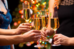 Women's hands with crystal glasses of champagne Royalty Free Stock Photos