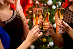 Women's hands with crystal glasses of champagne Stock Photo