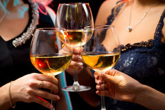 Women's hands with crystal glasses of wine Stock Images