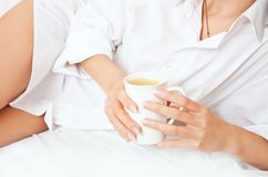 Women's hands with a cup of coffee Stock Photo