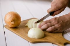 Women`s hands cut onions stock images