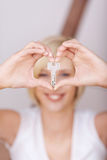 Women's Hands Forming Heart While Holding House Key Stock Photos