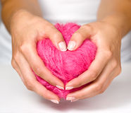 Women's hands with french. Ball of thread in women's hands stock image