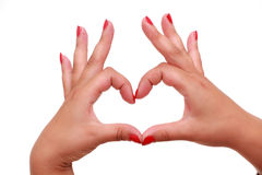 Women's hands gesturing heart sign Royalty Free Stock Image