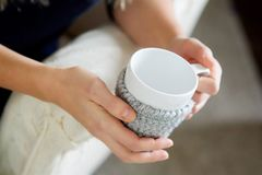 Women`s hands hold a Cup of drink in their hands. stock photo