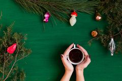 Women`s hands hold gift Christmas tree Christmas New Year holiday coffee background stock photo