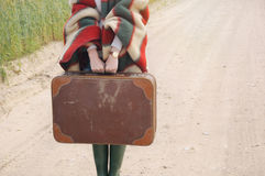 Women's hands hold old suitcase at autumn outdoor on the country Stock Images