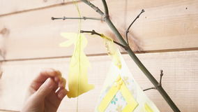 Women`s hands hold the sign for an Easter photo shoot stock footage