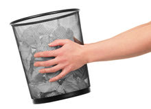 Women's hands are holding  bucket with paper isolated. Stock Photos