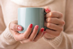 Women`s hands holding a cup of drink. Royalty Free Stock Images