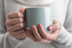 Women`s hands holding a cup of drink. Royalty Free Stock Photography