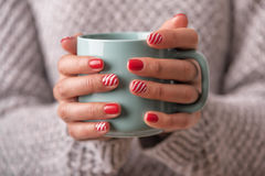 Women`s hands holding a cup of drink. Royalty Free Stock Photos