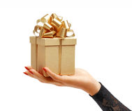 Women's hands holding gift box Royalty Free Stock Images