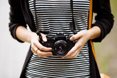 Women's hands holding the vintage film camera Royalty Free Stock Photo