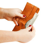 Women's hands are holding a wallet with money Royalty Free Stock Image