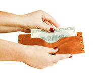 Women's hands are holding a wallet with money on the white backg Stock Photography