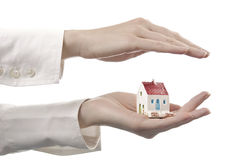 Women's hands with a house. Women's hands with a little house Stock Images