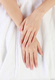 Women's hands on isolated a white cloth backgrou Stock Photography