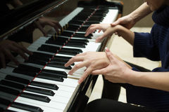 Women's hands on the keyboard of piano. girl plays Royalty Free Stock Photo