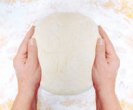 Women's hands knead the dough stock images
