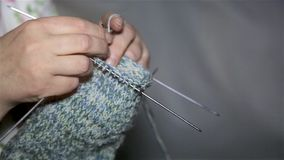 Women`s hands knit sock close-up stock video footage