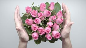 Bouquet of roses. 14. Women`s hands locate a bouquet of pink roses on the table. 14 stock video footage
