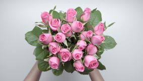 Bouquet of roses. 7. Women`s hands locate a bouquet of pink roses on the table. Speed up. 7 stock footage