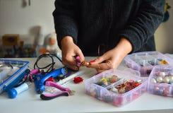 Women`s hands making beautiful jewelry. royalty free stock photography
