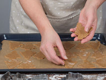 Women's hands making christmas cookies. Tradicional xmas dessert stock photography