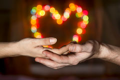 Women's hands in the men's hands holding a  bokeh Royalty Free Stock Images