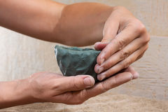 Women's hands molded from clay a tea bowl Stock Photo