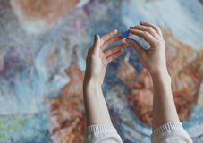 Women`s hands with a mosaic Royalty Free Stock Image