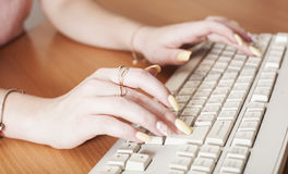 Women`s hands. Near the keyboard Royalty Free Stock Images