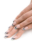 Women's hands with a nice manicure. Stock Photography
