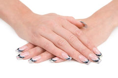 Women's hands with a nice manicure. Stock Photos