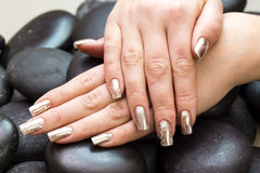 Women`s hands with a nice manicure Stock Images